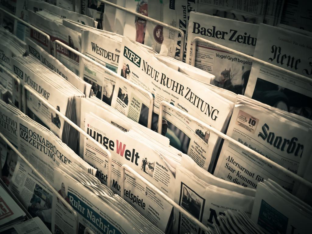 Newspapers in racks